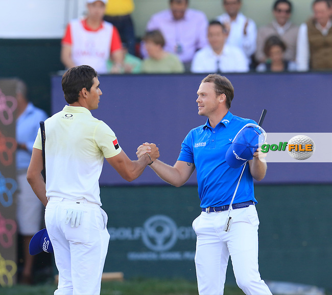 Danny Willett (ENG) playing with Rafa Cabrera-Bello (ESP)wins the tournament by 1 shot with a score of -19 at the end of Sunday's Final Round of the 2016 Omega Dubai Desert Classic held at the Emirates Golf Club, Dubai. 7th February 2016.<br /> Picture: Eoin Clarke | Golffile<br /> <br /> <br /> All photos usage must carry mandatory copyright credit (&copy; Golffile | Eoin Clarke)