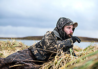 Guide with Four Flyways Outfitters Mark Vander Zanden while hunting in Cold Bay, Alaska, Thursday, November 3, 2016. The Izembek National Wildlife Refuge lies on the northwest coastal side of central Aleutians East Borough along the Bering Sea and Cold Bay. Birds hunted include the long tailed duck, the Steller's Eider, the Harlequin, the King Eider and Brant.<br /> <br /> <br /> Photo by Matt Nager