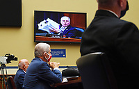 United States House Minority Whip Steve Scalise (Republican of Louisiana), is seen on a monitor as he holds up a stack of safety regulation documents as Dr. Anthony Fauci (C), director of the National Institute for Allergy and Infectious Diseases, Dr. Robert Redfield (L), director of the Centers for Disease Control and Prevention (CDC), and Adm. Brett Giroir, Assistant Secretary of Health and Human Services for Health, testify before a House Subcommittee on the Coronavirus Crisis hearing on a national plan to contain the COVID-19 pandemic, on Capitol Hill in Washington, DC on Friday, July 31, 2020.  Photo by Kevin Dietsch/UPI<br /> Credit: Kevin Dietsch / Pool via CNP /MediaPunch
