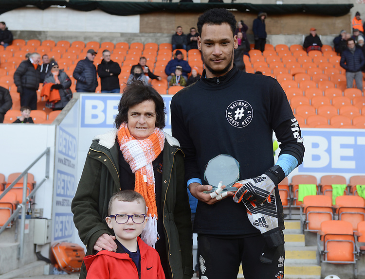 Blackpool's Christoffer Mafoumbi is presented with an award<br /> <br /> Photographer Kevin Barnes/CameraSport<br /> <br /> The EFL Sky Bet League One - Blackpool v Walsall - Saturday 9th February 2019 - Bloomfield Road - Blackpool<br /> <br /> World Copyright &copy; 2019 CameraSport. All rights reserved. 43 Linden Ave. Countesthorpe. Leicester. England. LE8 5PG - Tel: +44 (0) 116 277 4147 - admin@camerasport.com - www.camerasport.com