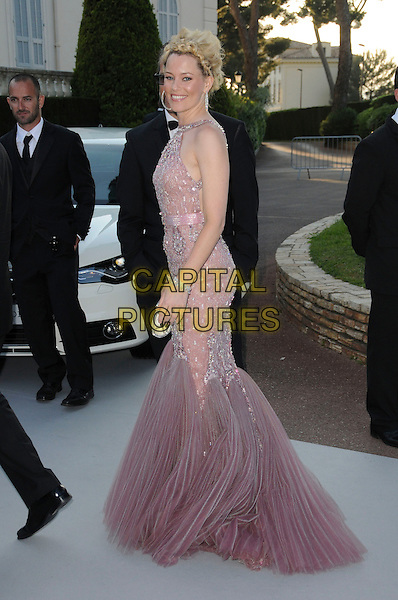 ELIZABETH BANKS.arrivals at amfAR's Cinema Against AIDS 2010 benefit gala at the Hotel du Cap, Antibes, Cannes, France during the Cannes Film Festival.20th May 2010.amfAR full length pink dusky fishtail dress silver beaded long maxi side.CAP/CAS.©Bob Cass/Capital Pictures.