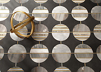 Lya, a waterjet stone mosaic, shown in honed Orpheus Black, Allure, polished Argent Blue, and Brass liners, is part of the Bright Young Things™ collection by New Ravenna.