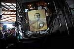 A campaign staffer for former House speaker and Republican presidential candidate Newt Gingrich places a portrait of late U.S. President Ronald Reagan, a gift from a supporter, in the front window of Gingrich's bus as the bus prepares to leave a campaign stop in Sarasota, Florida, USA, 24 January 2012. Republican candidates will campaign in Florida in the lead up to the Florida Primary on 31 January 2012.