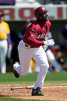 South Carolina second baseman Travis Jones (33) watches the flight of the ball as he heads towards first base versus LSU at Sarge Frye Stadium in Columbia, SC, Thursday, March 18, 2007.