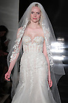 Model walks runway in a fit and flare silk organza gown with embroidered lace and matching veil, from the Reem Acra Spring 2017 bridal collection, during New York Bridal Fashion Week Spring Summer 2017, on April 15, 2016.