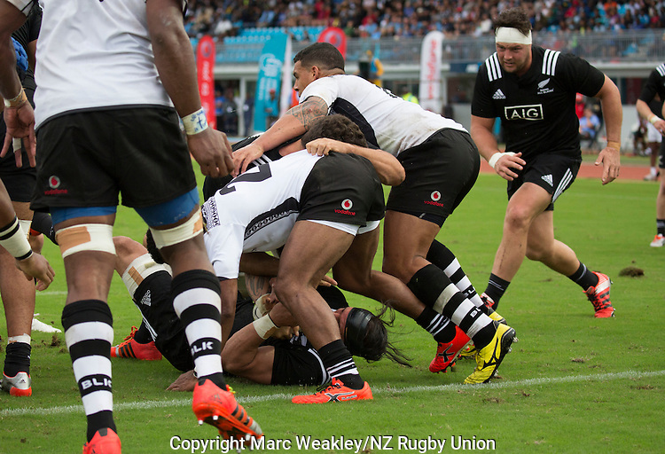 Elliot Dixon holds the ball. Maori All Blacks vs. Fiji. Suva. MAB's won 27-26. July 11, 2015. Photo: Marc Weakley