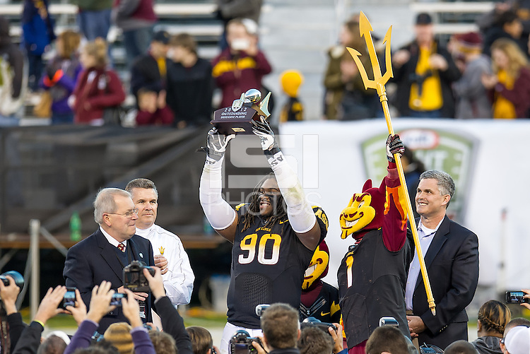 SAN FRANCISCO, CA - December 29, 2012: Arizonaa State defensive tackle Will Sutton (90) is awarded the Defensive Player of the Game after the Navy Midshipmen vs the Arizona State Sun Devils in the 2012 Kraft Fight Hunger Bowl at AT&T Park in San Francisco, California. Final score Navy 28, Arizona State 62.
