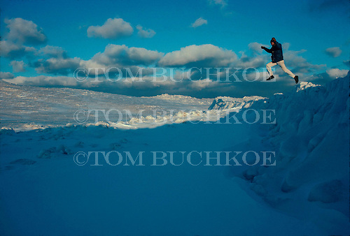 Spring fever, leap of faith, on the ice on Lake Superior