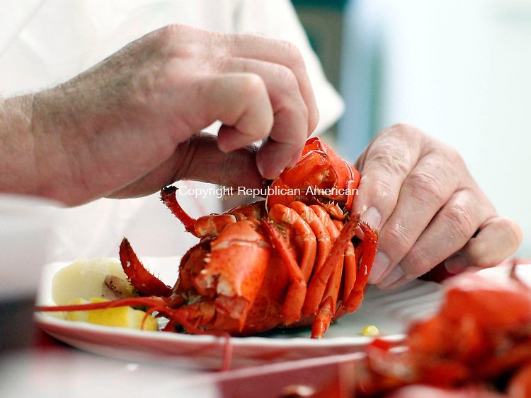Southbury, CT- 10 July 2013-071013CM04-  Ron Pivarnik, of Southbury cracks open a lobster during dinner at the Southbury Senior Center Wednesday afternoon.  A new Wind-Down Dinner series is featured at the center, which features a chef prepared meal.      Christopher Massa Republican-American