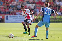 Easah Suliman of Cheltenham passes around Harry Cornick of Leyton Orient during the Sky Bet League 2 match between Cheltenham Town and Leyton Orient at the LCI Rail Stadium, Cheltenham, England on 6 August 2016. Photo by Mark  Hawkins / PRiME Media Images.