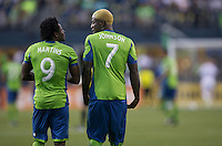 Obafemi Martins, left, of Seattle Sounders FC and Eddie Johnson of Seattle Sounders FC take the field against FC Dallas during a match at CenturyLink Field in Seattle Saturday August, 3, 2013. The Sounders defeated Dallas 3-0.