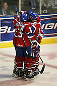 March 15, 2009:  Kenndal McArdle (22 - hidden) of the Rochester Amerks, AHL affiliate of Florida Panthers, is congratulated by Jason Garrison (3), Peter Aston (12), and Randall Gelech (42) after scoring a goal during the second period of a regular season game at the Blue Cross Arena in Rochester, NY.  Hamilton defeated Rochester 4-3 in a shoot out.  Photo Copyright Mike Janes Photography 2009