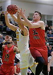SPEARFISH, SD: DECEMBER 30:  Jason Anderson #34 of CSU Pueblo and Antonio Capley #35 of Black Hills State battle for a rebound during their game Saturday evening at the Donald E. Young Center in Spearfish, S.D.   (Photo by Dick Carlson/Inertia