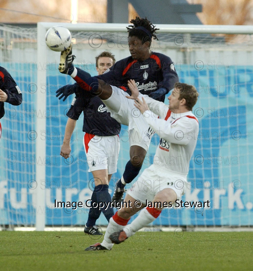 26/12/2004  Copyright Pic : James Stewart.File Name : jspa08_falkirk_v_airdrie.RUSSELL LATAPY GETS THE BETTER OF MARVIN WILSON...Payments to :.James Stewart Photo Agency 19 Carronlea Drive, Falkirk. FK2 8DN      Vat Reg No. 607 6932 25.Office     : +44 (0)1324 570906     .Mobile   : +44 (0)7721 416997.Fax         : +44 (0)1324 570906.E-mail  :  jim@jspa.co.uk.If you require further information then contact Jim Stewart on any of the numbers above.........
