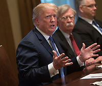 United States President Donald J. Trump makes statements on the ongoing investigation of  election meddling and on the current situation in Syria during a meeting with senior military leadership at The White House in Washington, DC, March 9, 2018. Seated next to Trump is National Security Advisor John Bolton. <br /> <br /> CAP/MPI/RS<br /> &copy;RS/MPI/Capital Pictures