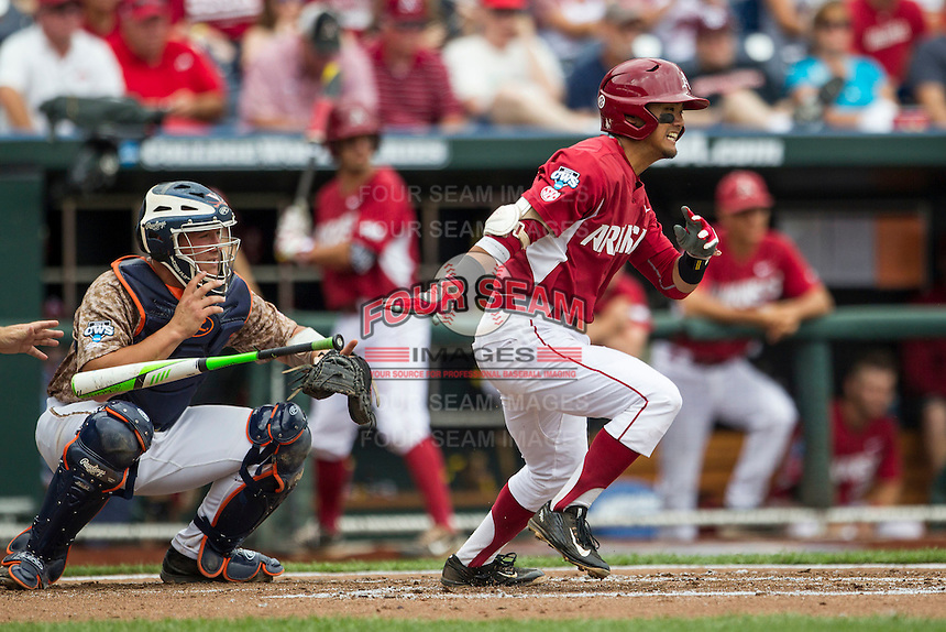 Arkansas Razorbacks second baseman Rick Nomura (1) follows through on his swing against the Virginia Cavaliers in Game 1 of the NCAA College World Series on June 13, 2015 at TD Ameritrade Park in Omaha, Nebraska. Virginia defeated Arkansas 5-3. (Andrew Woolley/Four Seam Images)