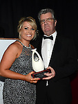 Jennifer Byrne from You're Gorgeous Hair (ygh.ie) receives the Best Beauty and Hair award from Jim Corcoran representing sponsor Bellewstown Races at the Business Excellence Awards in Earth Night Club at the Westcourt Hotel. Photo:Colin Bell/pressphotos.ie
