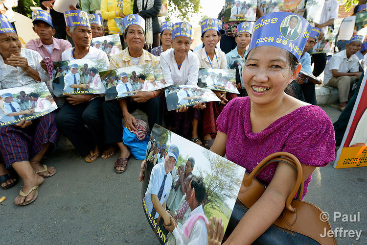 "Women participate in a vigil outside a Phnom Penh court on December 14, 2012, during a hearing in which judges denied an appeal by Mam Sonando, a Cambodian radio journalist and human rights activist. Mam Sonando was sentenced in October 2012 to 20 years in prison for ""insurrection,"" despite local and international calls for his release."