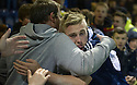 Scotland's Calvin Miller celebrates with fans at the end of the match.