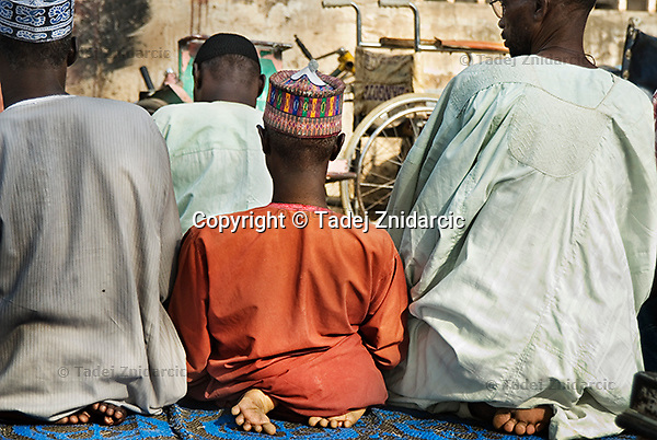 Members of KPVTA praying at their headquarters in Kano. Majority of the population in the north of Nigeria is Muslim.