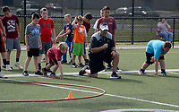 Graham Thomas/Herald-Leader<br /> Siloam Springs head football coach Brandon Craig puts Panther Academy campers through drills during a session on June 11 at Panther Stadium.
