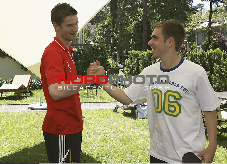FIFA WM 2006 - BERLIN - JUNE 11:  <br /> <br /> Arne Friedrich (L) and Philipp Lahm (R) of Germany shaking hands after a table tennis match at the Hotel Garden during a rest day of the Germany National Team at the squad hotel on June 11, 2006 in Berlin, Germany<br /> <br /> Foto &copy; nordphoto