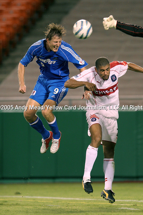 19 August 2005: Sasha Victorine (9), C.J. Brown (2), and Fire goalkeeper Zach Thornton (arm at the top) all challenge for the ball. The Kansas City Wizards defeated the Chicago Fire 3-0 at the Arrowhead Stadium in Kansas City, Missouri in a Major League Soccer regular season game.