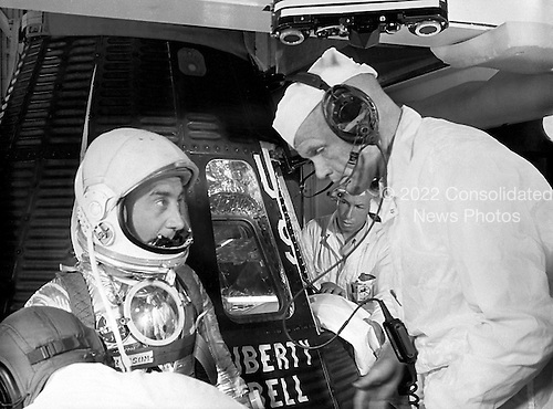 Astronaut Virgil Grissom chats with Astronaut John Glenn prior to entering the Liberty Bell 7 capsule for the MR-4 Mission at Cape Canaveral, Florida on July 21, 1961. The MR-4 mission was the second manned suborbital flight using the Mercury-Redstone booster, which was developed by the Marshall Space Flight Center..Credit: NASA via CNP