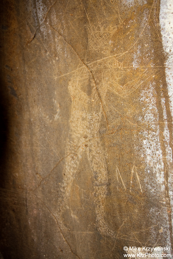 Hawaiian petroglyph of human figure wearing a crown & holding a rifle, Nuuanu, Honolulu, Oahu, Hawaii