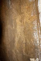 Hawaiian petroglyph of human figure wearing a crown & holding a rifle, Nuuanu, Honolulu, Oahu, Hawaii