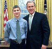 "Christopher Hassan-Houghton, prize winner in the U.S. - U.K. Millennium essay contest for the essay ""The Fight for Freedom"" poses with United States President George W. Bush in the Oval Office of the White House in Washington, DC on February 22, 2001. <br /> Mandatory Credit: Paul Morse / White House via CNP"