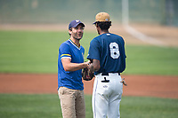 A Milwaukee Brewers fan meets Helena Brewers outfielder Je'Von Ward (8) after throwing out the first pitch before a Pioneer League game between the Helena Brewers and the Grand Junction Rockies at Kindrick Legion Field on August 19, 2018 in Helena, Montana. The Grand Junction Rockies defeated the Helena Brewers by a score of 6-1. (Zachary Lucy/Four Seam Images)