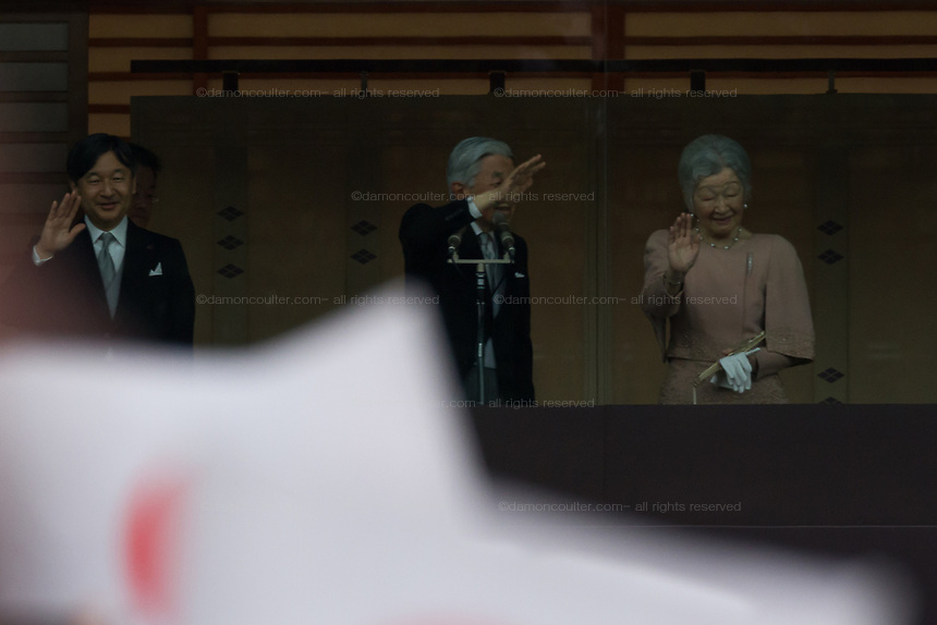 (From Left to Right)  Crown Prince Naruhito, Emperor Akihio and Empress Michiko wave to well-wishers at the Imperial Palace to celebrate the 85th birthday of Emperor Akihito of Japan. The Emperor, who is the son of Japan's wartime leader, Emperor Hirohito, gave a speech to mark his last birthday before his upcoming abdication, saying he felt relief that his reign was coming to an end without having seen his country at war again and that it was important to continue to educate young people about japan's wartime past. Imperial Palace, Tokyo, Japan. Sunday December 23rd 2018