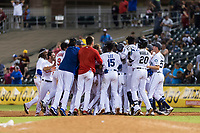 AFL West catcher Meibrys Viloria (9), of the Surprise Saguaros and Kansas City Royals organization, is mobbed by his teammates after hitting a game-winning walk-off single in the bottom of the ninth inning of the Arizona Fall League Fall Stars game at Surprise Stadium on November 3, 2018 in Surprise, Arizona. The AFL West defeated the AFL East 7-6 . (Zachary Lucy/Four Seam Images)
