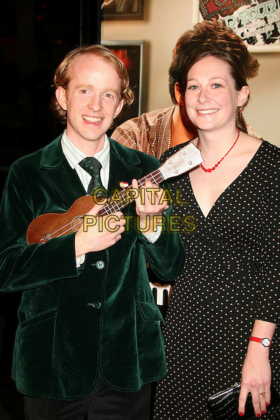 "JACOB FAUCHARD & SARAH GEORGE.""Music and Lyrics"" Los Angeles Premiere at Grauman's Chinese Theatre, Hollywood, California, USA..February 7th, 2007.half length black polka dot dress guitar ukulele green jacket.CAP/ADM/BP.©Byron Purvis/AdMedia/Capital Pictures"
