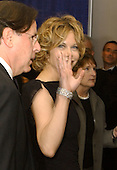 Washington, DC - May 1, 2004 -- Meg Ryan rushes past photographers offering only but a little wave as she arrives for the 2004 White House Correspondents Association Dinner in Washington, D.C. on May 1, 2004..Credit: Ron Sachs / CNP.(RESTRICTION: No New York Metro or other Newspapers within a 75 mile radius of New York City)