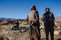 MUDAD VILLAGE, CHAK VALLEY, WARDAK PROVINCE, AFGHANISTAN - NOVEMBER 11, 2013: Colonel Daowood interrogates a villager, as to the location of ied's planted by the Taliban, during a re-supply mission in the Chak valley on November 11, 2013 in Mudad Village, Chak Valley, Wardak Province, Afghanistan. 600 ANA soldiers advanced through the Chakh valley, a haven for Taliban and insurgent fighters, to re-supply a base for the winter.