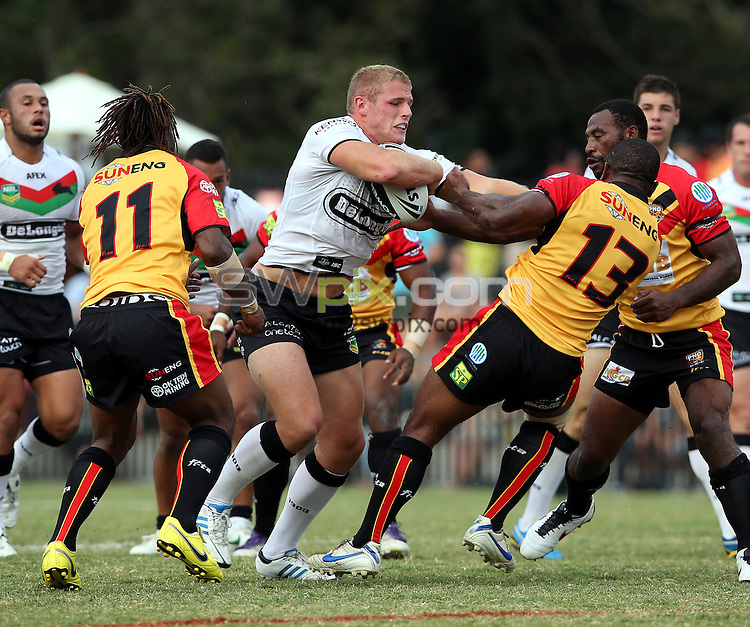 PICTURE BY PAUL SEISER/SWPIX.COM - Rugby League - NRL Preseason - Return to Redfern 2013 - South Sydney Rabbitohs v Papua New Guinea - Redfern Oval, Sydney, Australia - 09/02/13 - South Sydney's Tom Burgess.
