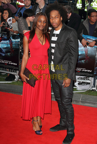 guest & Lemar Obika.UK Premiere of 'The Amazing Spider-Man' at the Odeon, Leicester Square, London, England..June 18th 2012.full length black jacket white striped stripes top jeans denim afro hair red dress clutch bag.CAP/ROS.©Steve Ross/Capital Pictures.