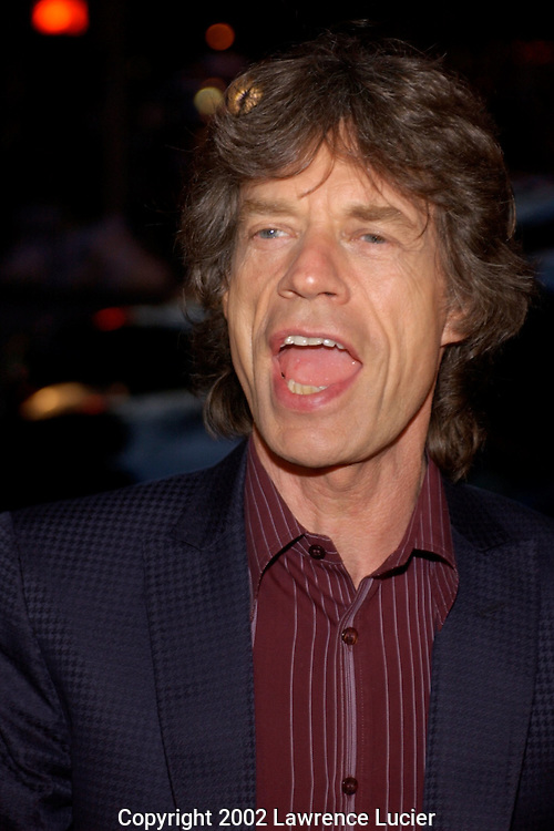 Rock superstar Mick Jagger arrives at the benefit premier of Enigma April 11, 2002, in New York.  The benefit supports the International Rescue Committee which provides emergency and long term aid to refugees in over 30 countries..