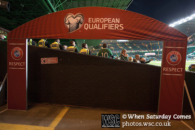 Scotland 1 Republic of Ireland 0, 14/11/2014. Celtic Park, European Championship qualifying. Away fans framed by UEFA equipment beside the pitch before the European Championship qualifying match between Scotland and the Republic of Ireland at Celtic Park, Glasgow. Scotland won the match by one goal to nil, scored by Shaun Maloney 16 minutes from time. The match was watched by 55,000 at Celtic Park, the venue chosen to host the match due to Hampden Park's unavailability following the 2014 Commonwealth Games. Photo by Colin McPherson.