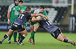 No way through for Connacht centre Craig Ronaldson as Ospreys pair Dmitri Arhip and Marc Thomas close in.<br /> Guiness Pro12<br /> Ospreys v Connacht<br /> Liberty Stadium<br /> 31.10.14<br /> &copy;Steve Pope-SPORTINGWALES