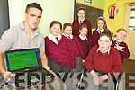 WHITEBOARDS: Pupils at Lyreacrompane national school checking out one of their brand new interactive whiteboards, with teacher Kieran Quirke, front l-r: Mary Murphy, Michaela Lenihan, Sarah Fahey, Mikie Lenihan, Caoimhe Roche. Back l-r: Aoife Healy, Lorraine Nash.