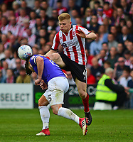 Lincoln City's Elliott Whitehouse vies for possession with Exeter City's Jordan Moore-Taylor<br /> <br /> Photographer Andrew Vaughan/CameraSport<br /> <br /> The EFL Sky Bet League Two Play Off First Leg - Lincoln City v Exeter City - Saturday 12th May 2018 - Sincil Bank - Lincoln<br /> <br /> World Copyright &copy; 2018 CameraSport. All rights reserved. 43 Linden Ave. Countesthorpe. Leicester. England. LE8 5PG - Tel: +44 (0) 116 277 4147 - admin@camerasport.com - www.camerasport.com