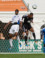 Ethan White (15) of D.C. United goes up for a header with Khari Stephenson (7) of the San Jose Earthquakes during the game at RFK Stadium in Washington, DC.  D.C. United was defeated by the San Jose Earthquakes, 4-2.