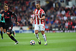 Jese of Stoke City is challenged by Aaron Ramsey of Arsenal during the premier league match at the Britannia Stadium, Stoke. Picture date 19th August 2017. Picture credit should read: Robin Parker/Sportimage