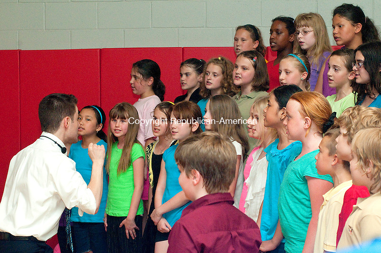 TORRINGTON, CT, 01 JUNE 2011-060111JS01--Fourth and fifth grade chorus students from Southwest School in Torrington, led by Matthew Bell, Director, left,  sing &quot;America, My Country&quot; during the annual Harambe 2011 at the school on Wednesday. Harambe means Come Together as One in Swahili.<br /> Jim Shannon/Republican-American