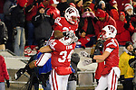 Wisconsin Badgers Bradie Ewing (34) and Jared Abbrederis (4) celebrate running back James White (20) touchdown runn during an NCAA college football game against the Northwestern Wildcats on November 27, 2010 at Camp Randall Stadium in Madison, Wisconsin. The Badgers won 70-23. (Photo by David Stluka)
