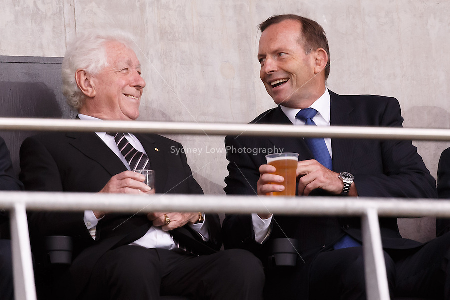 Frank Lowy Chairman of the Football Federation Australia   and the Australian Prime Minister Tony Abbott share a drink at the 2015 AFC Asian Cup match between Australia and Kuwait at the Melbourne Rectangular Stadium on 9 January 2015
