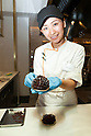 A member of staff shows a Gingerbread Pinecone during the pre-opening event for the new pastry shop ''Dominique Ansel Bakery'' in Omotesando Hills on June 17, 2015, Tokyo, Japan. The new brand is known for its Cronuts pastry; a croissant doughnut fusion creation by Chef Dominique Ansel and is already hugely popular in New York. This is the first time that it will open an international branch. Japan has seen a recent boom in international food retailers especially trying to become the latest new trend in Tokyo. The store opens its doors to the public on June 20th and long lines are expected. (Photo by Rodrigo Reyes Marin/AFLO)
